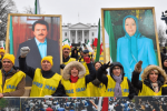 Demonstrations hold portraits of Iranian politicians Massoud Rajavii and his wife, Maryam Rajavi, at a rally help by the Organization of Iranian-American Communities
